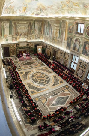 """This handout picture released on December 22, 2014 by the Vatican press office shows Pope Francis delivers his speeches to the prelates during the audience of the Curia, the administrative apparatus of the Holy See, for Christmas greetings in the Sala Clementina of the Apostolic Palace at the Vatican. AFP PHOTO / OSSERVATORE ROMANO/HO RESTRICTED TO EDITORIAL USE - MANDATORY CREDIT """"AFP PHOTO / OSSERVATORE ROMANO"""" - NO MARKETING NO ADVERTISING CAMPAIGNS - DISTRIBUTED AS A SERVICE TO CLIENTSOSSERVATORE ROMANO/AFP/Getty Images"""
