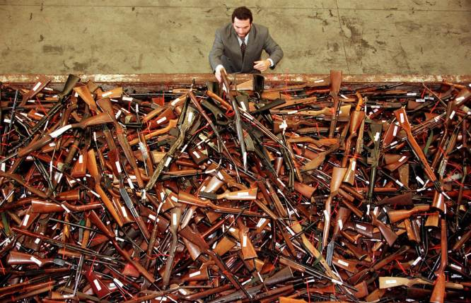 A pile of about 4,500 firearms that were handed over as part of Australia's buyback. David Gray / Reuters
