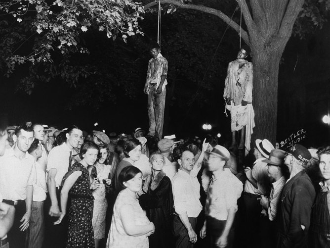 On Aug. 7, 1930, Lawrence Beitler took this photograph of Thomas Shipp and Abram Smith, lynched in the town center of Marion, Ind., for allegedly murdering a white factory worker, Claude Deeter, and raping his companion, Mary Ball. But the case was never solved.