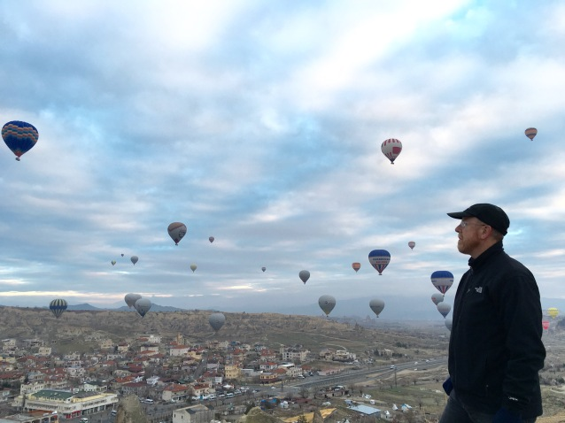 Looking on to the hot air balloons lifting over the Cappadocian Valley